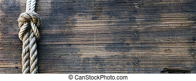wooden board with rope - wooden board with a rough texture...