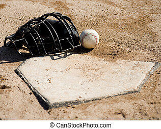 Baseball Equipment - A baseball catchers protective mask and...