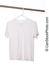 White T-Shirt - A white blank t-shirt hanging in front of a...