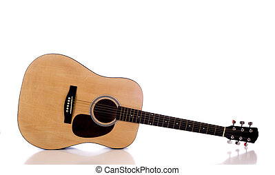Acoustic Guitar on White - A wooden acoustic guitar on a...