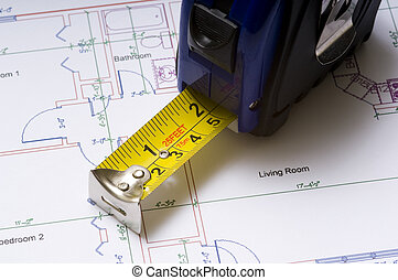 Tape Measure on Floor Plans - A tape measure on construction...