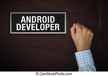 Businessman knocking on Android Developer door - Businessman...