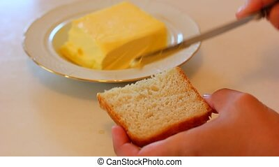 Buttering a piece of bread
