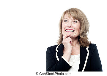 Mature woman thinking isolated on white - Smiling senior...