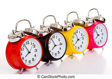 Alarm Clocks - Several brightly colored traditional alarm...