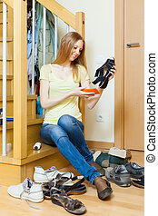 Happy blonde housewife with shoes