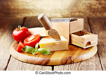 parmesan cheese with grater on wooden background