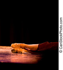 Ballet Feet - A performer laying on a stage under stage...