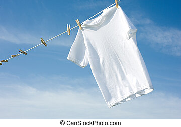 Plain White T-Shirt on a Clothesline - A plain white T-shirt...