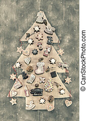 Christmas decoration: wooden carved tree decorated with...
