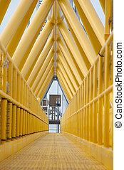 Gangway or walkway linked between production platform and...