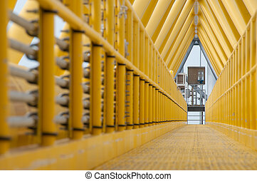 Gangway or walkway linked between production platform and...
