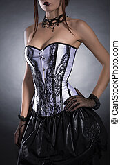 Elegant woman in black and white corset