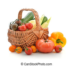 Organic vegetables in the wicker basket isolated on white...