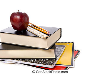 School Books with Apple - A stack of school books and spiral...
