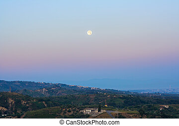 Full moon perigee during sunrise in sicily - Full moon...