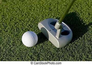 Golf Putt - A short put in the game of golf with a ball and...