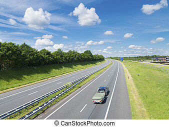highway in the netherlands - highway with home going...