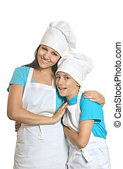 Smiling female chef with assistants - Smiling female chef...