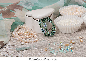 Beads Jewelry On Natural Linen Background. Hand Made.