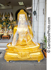 buddha wrapped in plastic