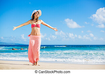 Happy woman at the beach - Relaxing beach vacation. Happy...