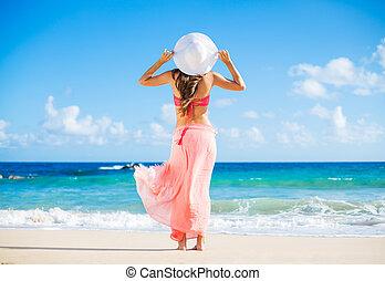 Happy woman at the beach - Beach vacation. Happy woman...