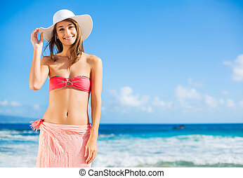 Happy woman at the beach - Happy woman enjoying sunny day at...
