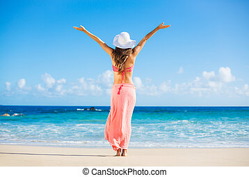 Happy woman at the beach - Beach vacation. Happy woman...