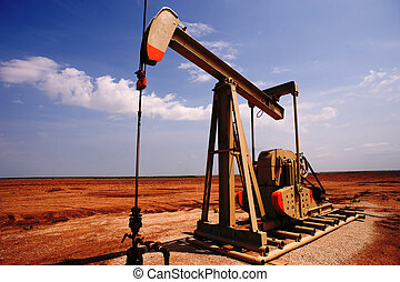 Oil and Gas - An oil pump or pumpjack on the plains of west...