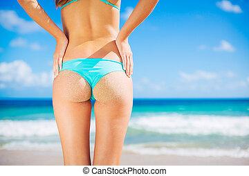 Sexy woman in small bikini on the beach - Sexy girl with...