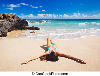 Woman relaxing on beautiful tropical beach - Attractive sexy...