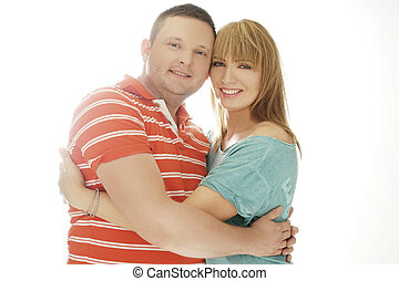 Happy Couple Embracing While Looking at Camera