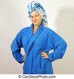 woman in bathrobe with towel on head