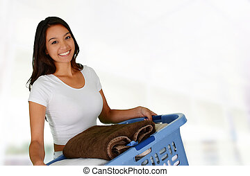 Laundry - Woman who is doing laundry in her home