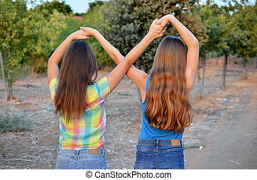 Two best friend girls making a forever sign - Best Friends...