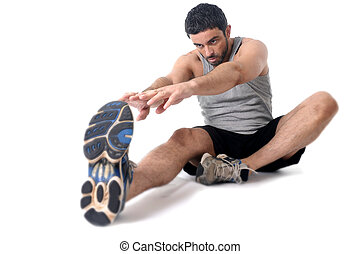 young athletic sport man stretching workout of legs...