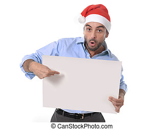 handsome business man in santa christmas hat pointing blank...