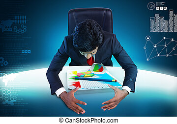 Business man studying the financial graph and pie chart