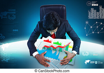 Business man studying the financial graph