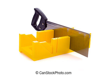 Miter Box with Saw - A small yellow miter box or saw on a...