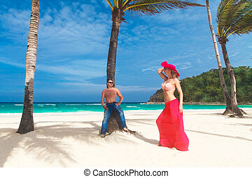 young loving couple on the tropical beach