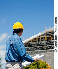 Construction Worker at Site - A construction worker or...