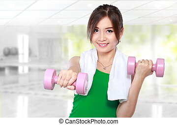 fitness woman with free weights - Pretty happy young woman...