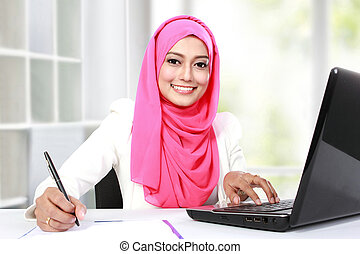 woman working with laptop - portrait of young asian woman...