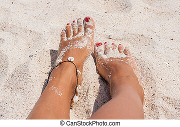 Relaxing at a beach, with your feet on the sand. - Relaxing...
