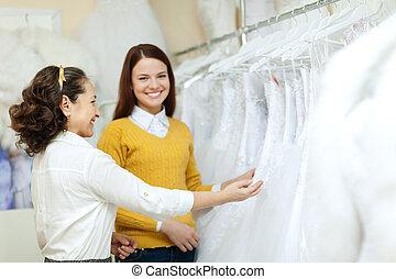 Two women chooses bridal gown - Two women chooses bridal...