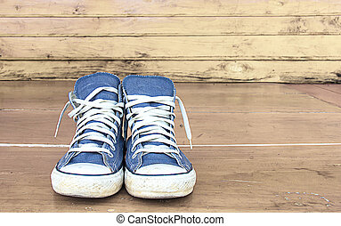 blue sneakers on the wooden floor, vintage.