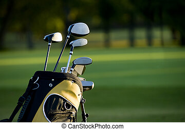 Golfing - A set up new golf clubs on a beautiful golf course...