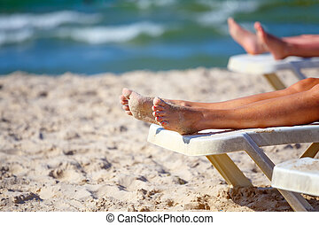 woman legs relaxing on the beach in sunny day, on tunisian...